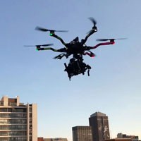 Drone from Hamman Drones airborne with buildings in background