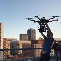 drone operator from Hamman Drones launching drone